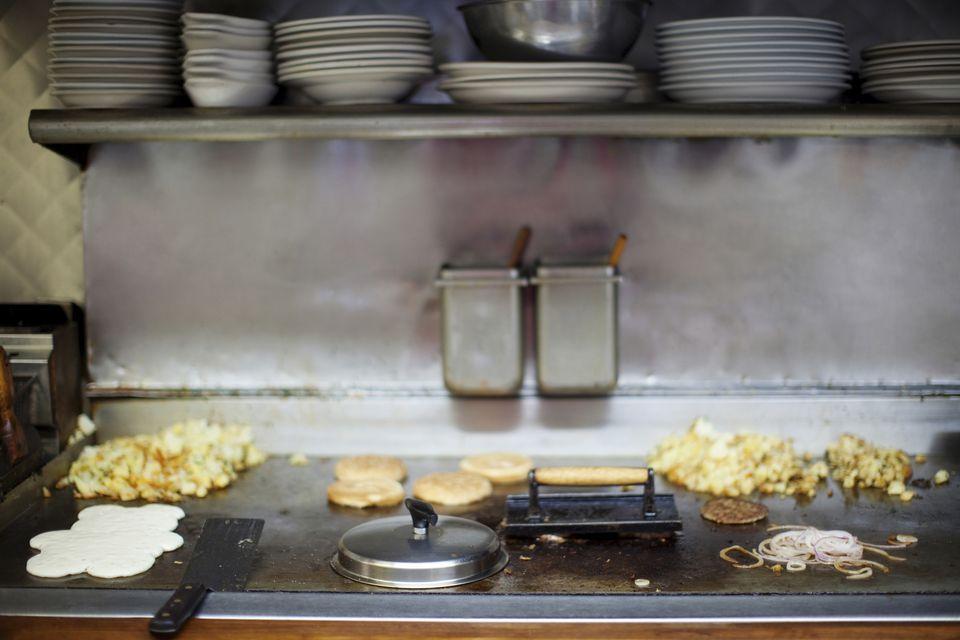 Breakfast cooking on diner griddle