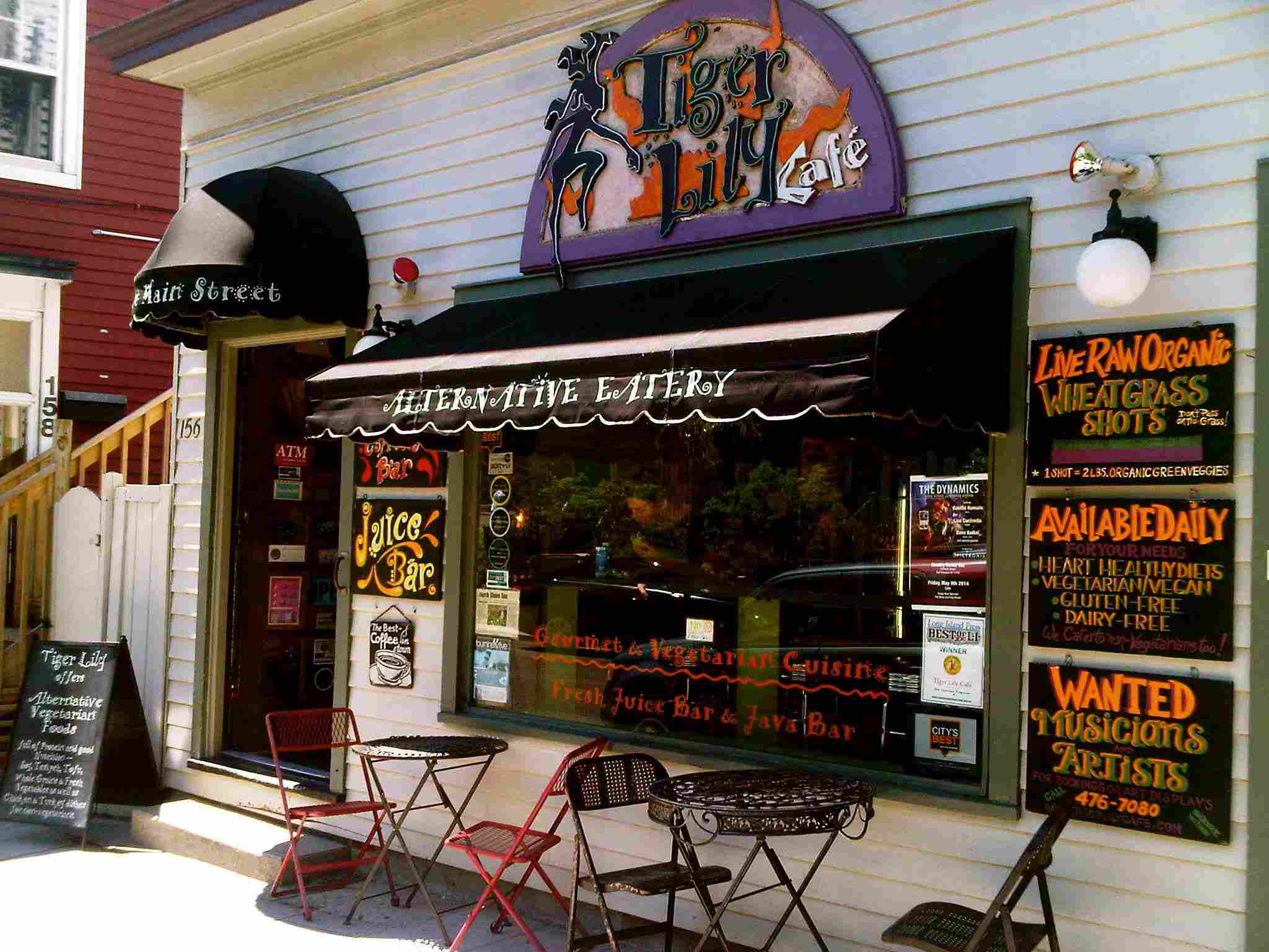 Exterior of Tiger Lily Café with outdoor seating