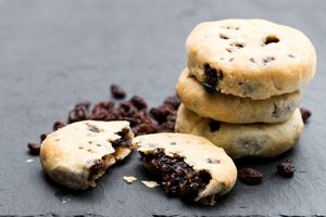 Stack of Eccles cakes on black stone background