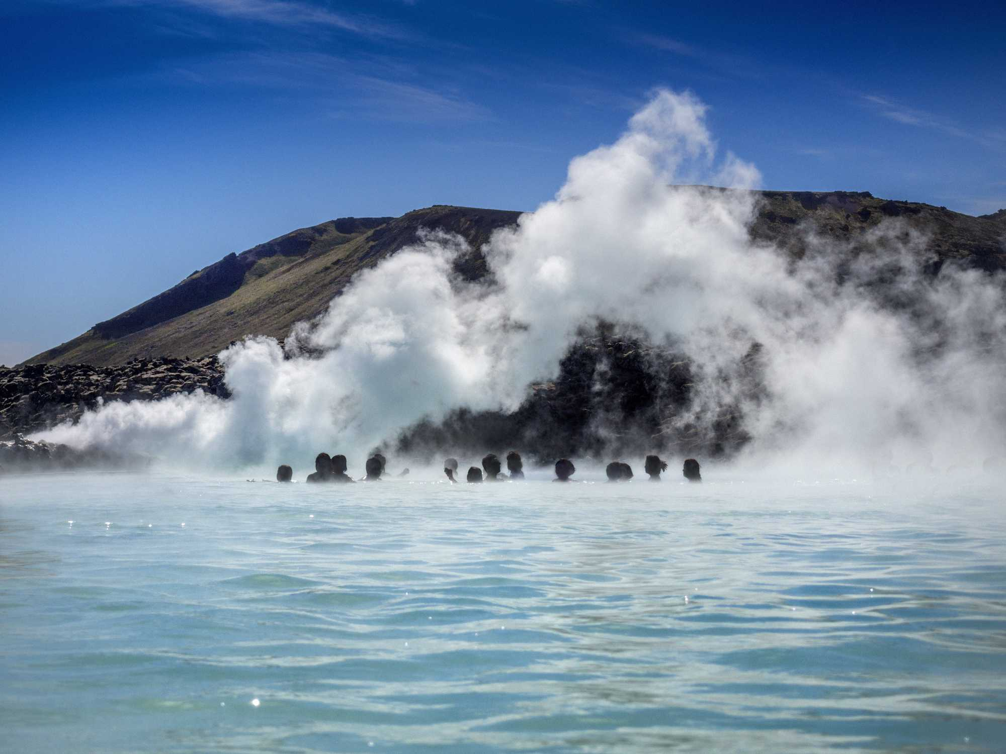 People enjoying the water at the Blue Lagoon, Southern Peninsula, Iceland