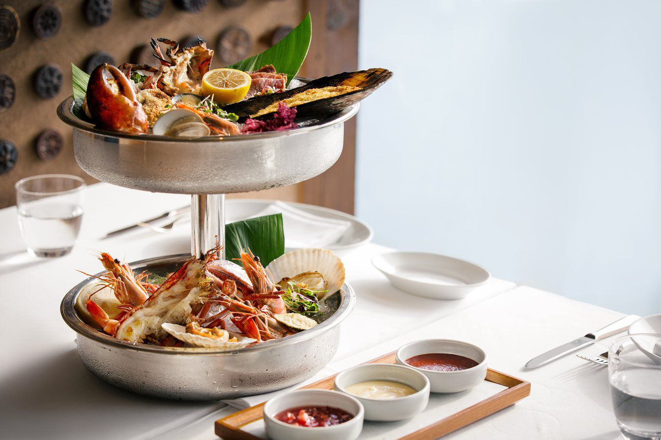 Two level seafood tower on a white table