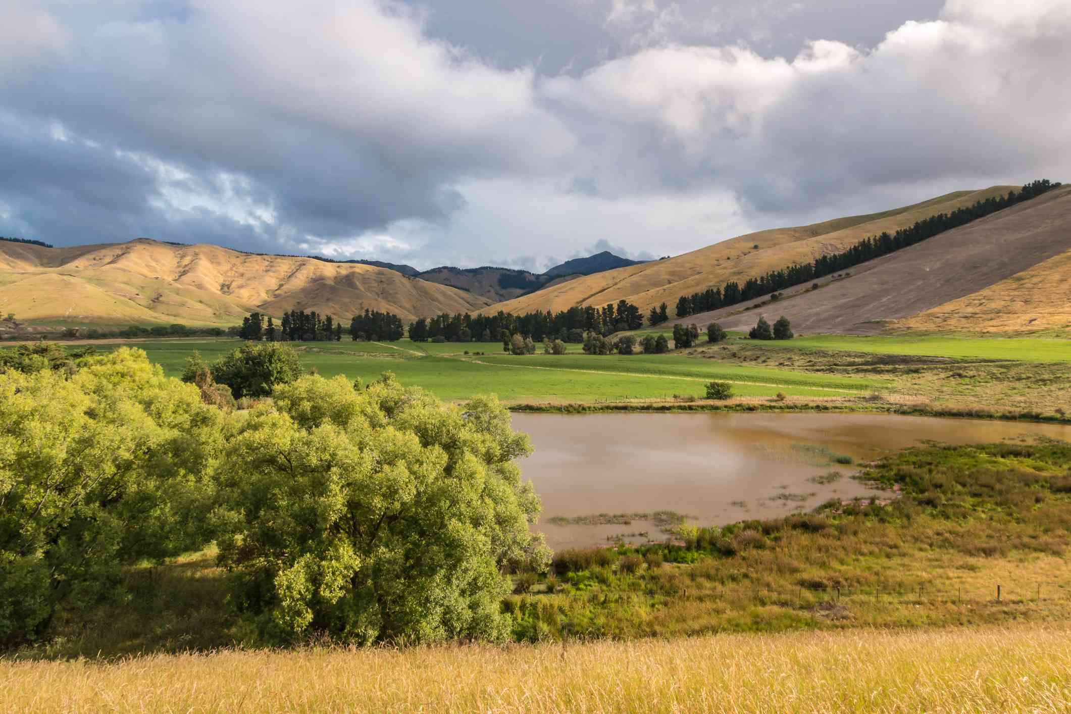dramatic sky above Wither Hills and Taylor dam lake near Blenheim, South Island, New Zealand