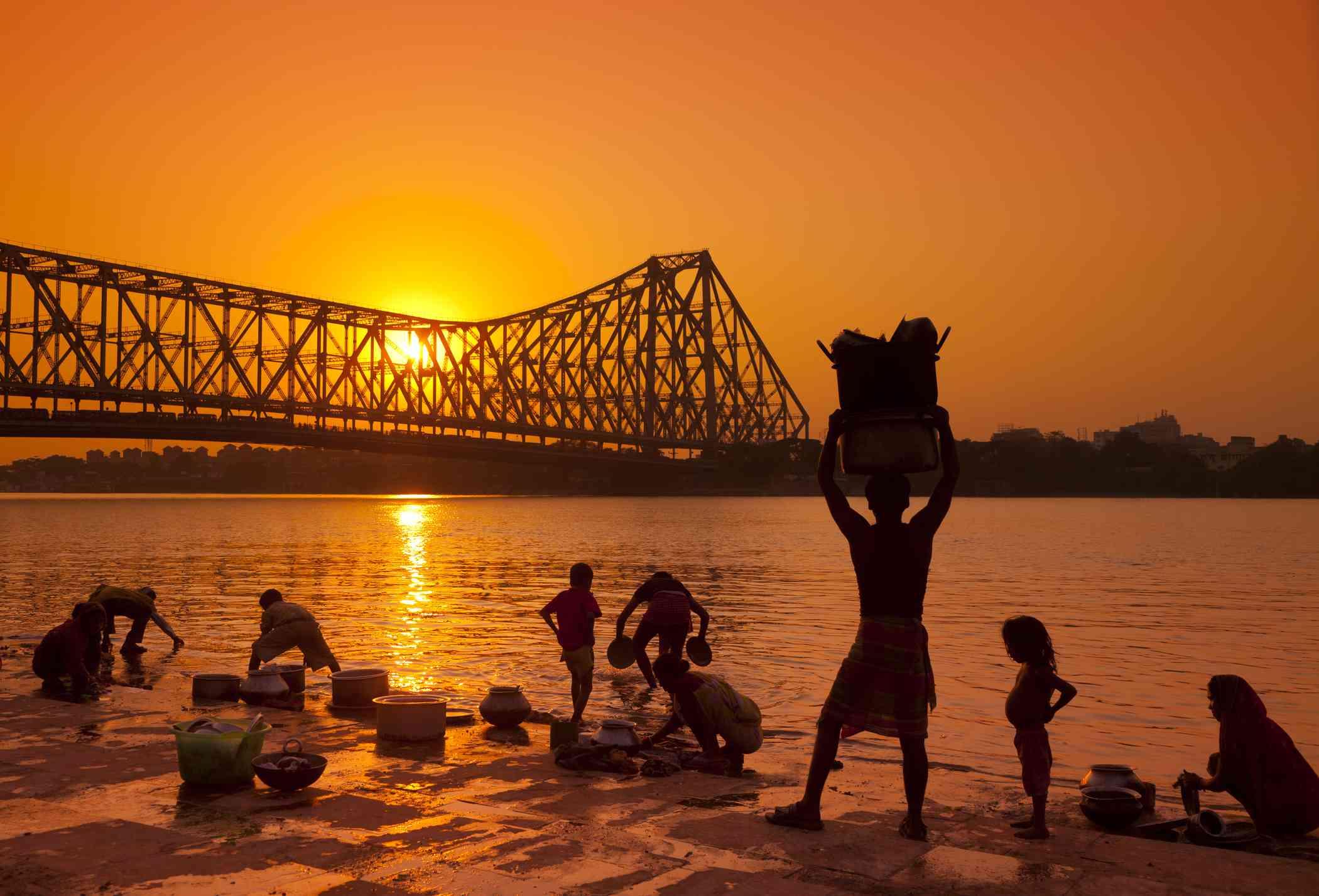 Familes washing in Hooghly River, Kolkata.