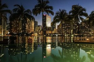 View Of Miami Waterfront Lit Up At Night