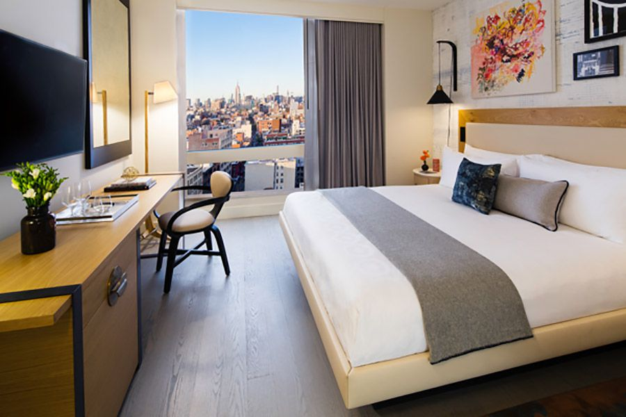 King bed with city view at the Hotel 50 Bowery NYC