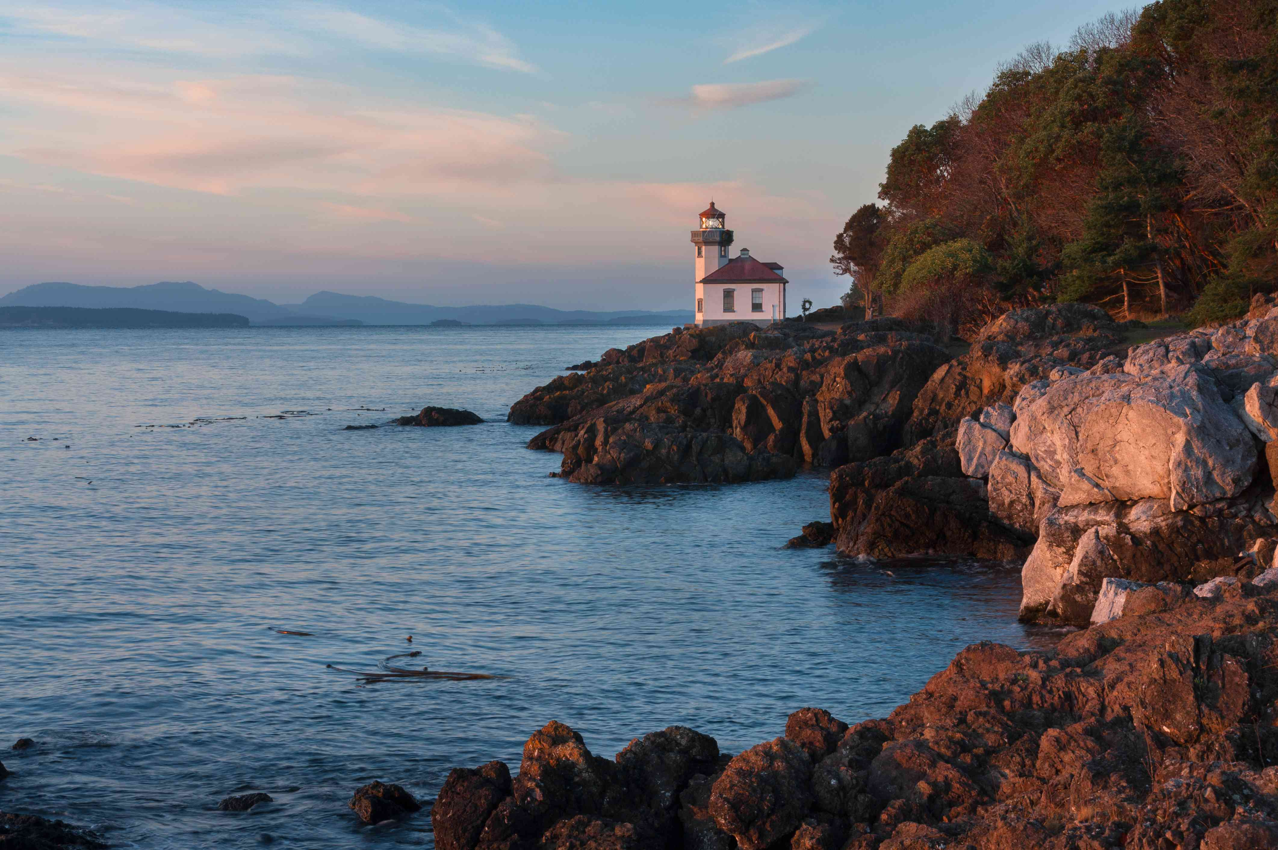 Scenic View Of Lime Kiln Lighthouse By Sea Against Sky On San Juan Island