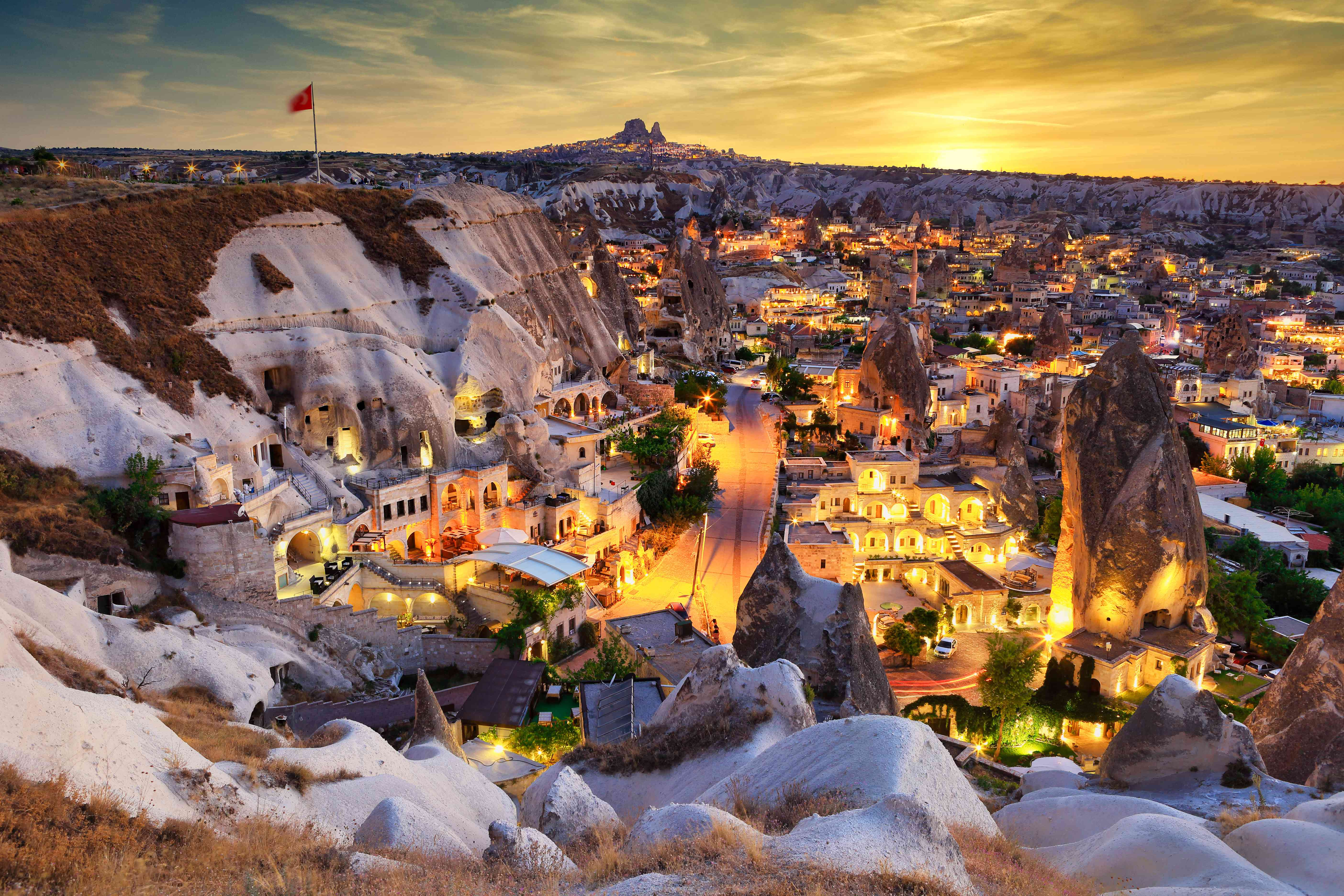 Aerial view of Goreme Village at dusk with street lights on