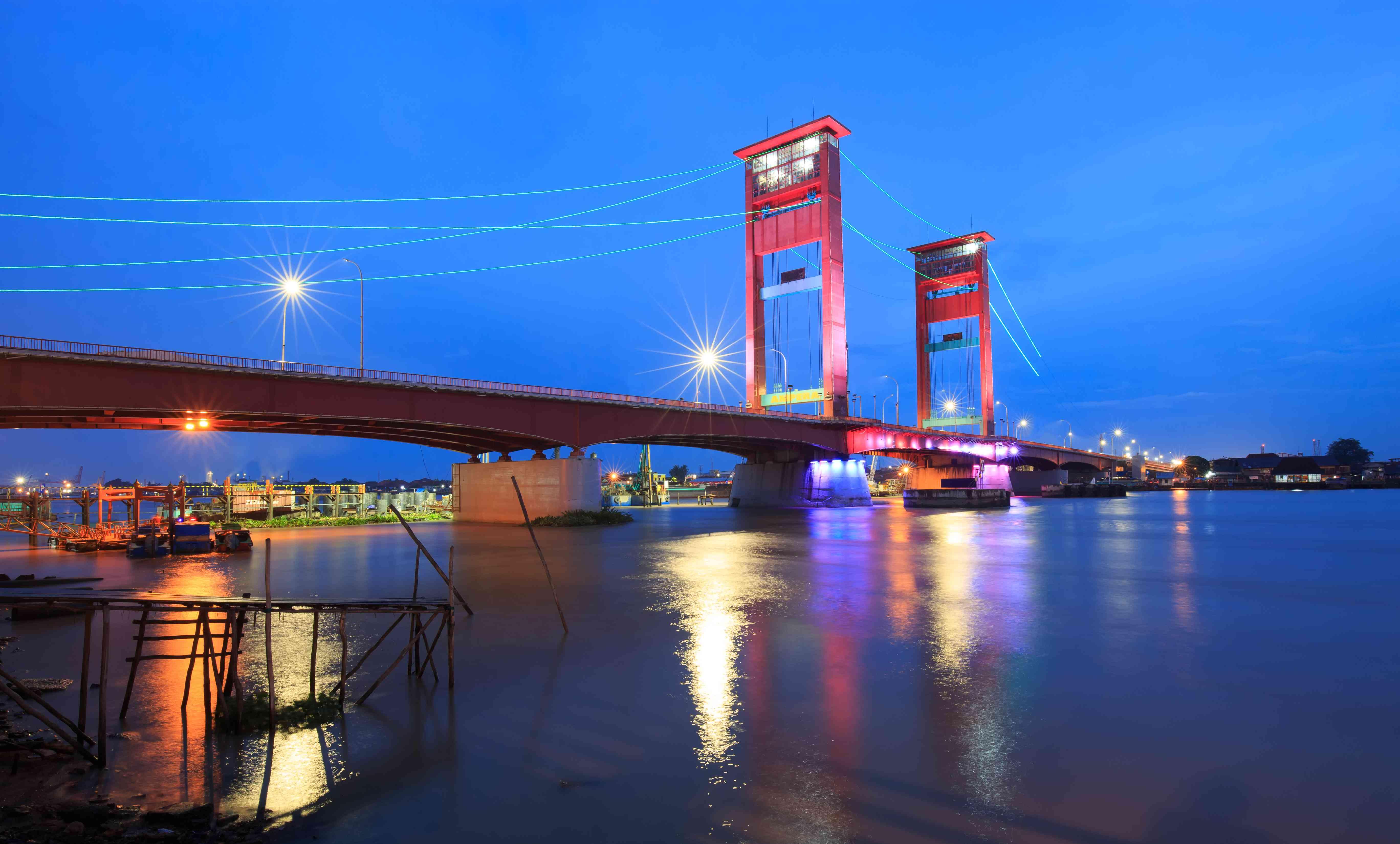 Ampera Bridge in Palembang, South Sumatra, lit up at night