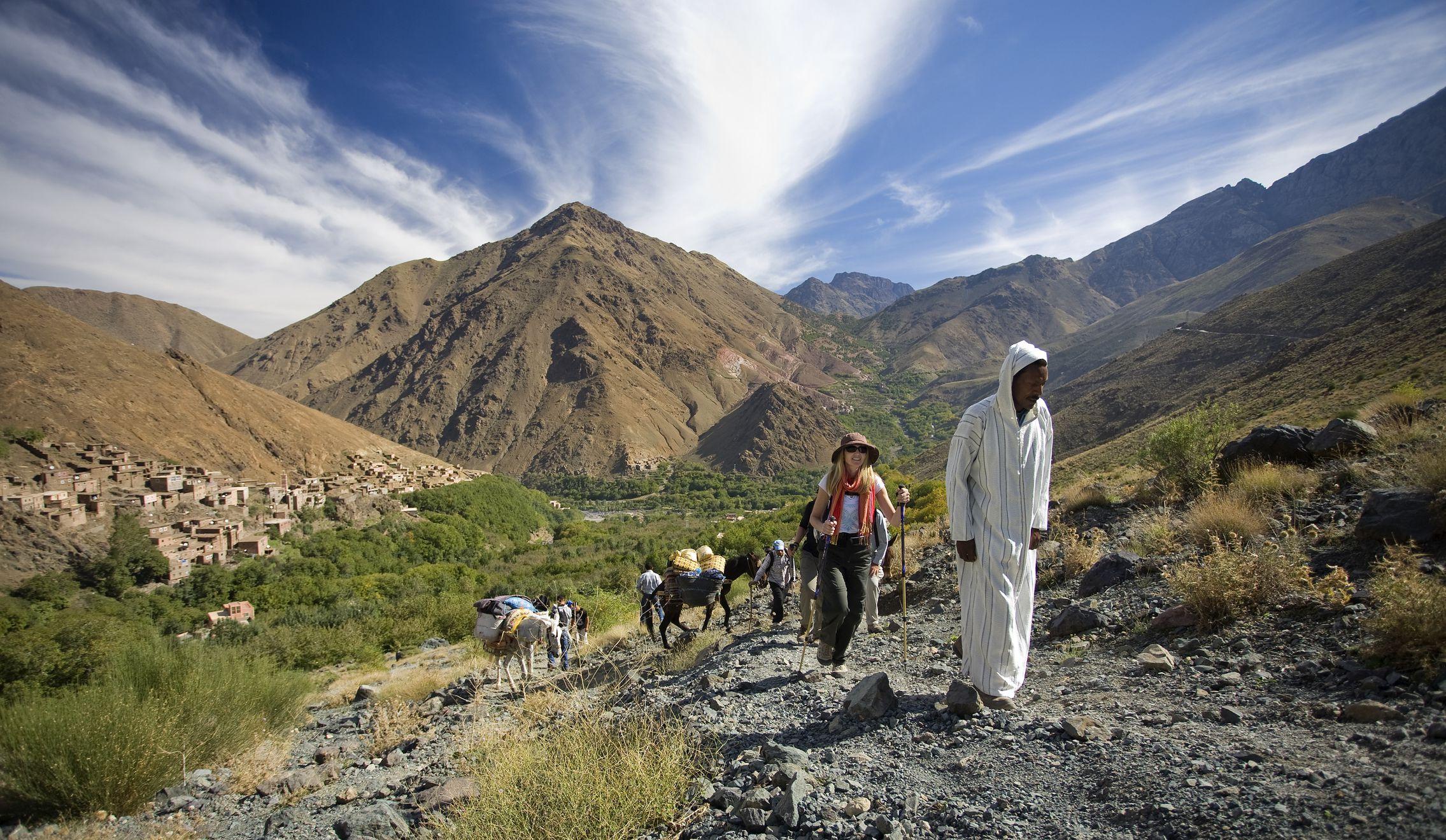 A guide leads trek through the Atlas Mountains.