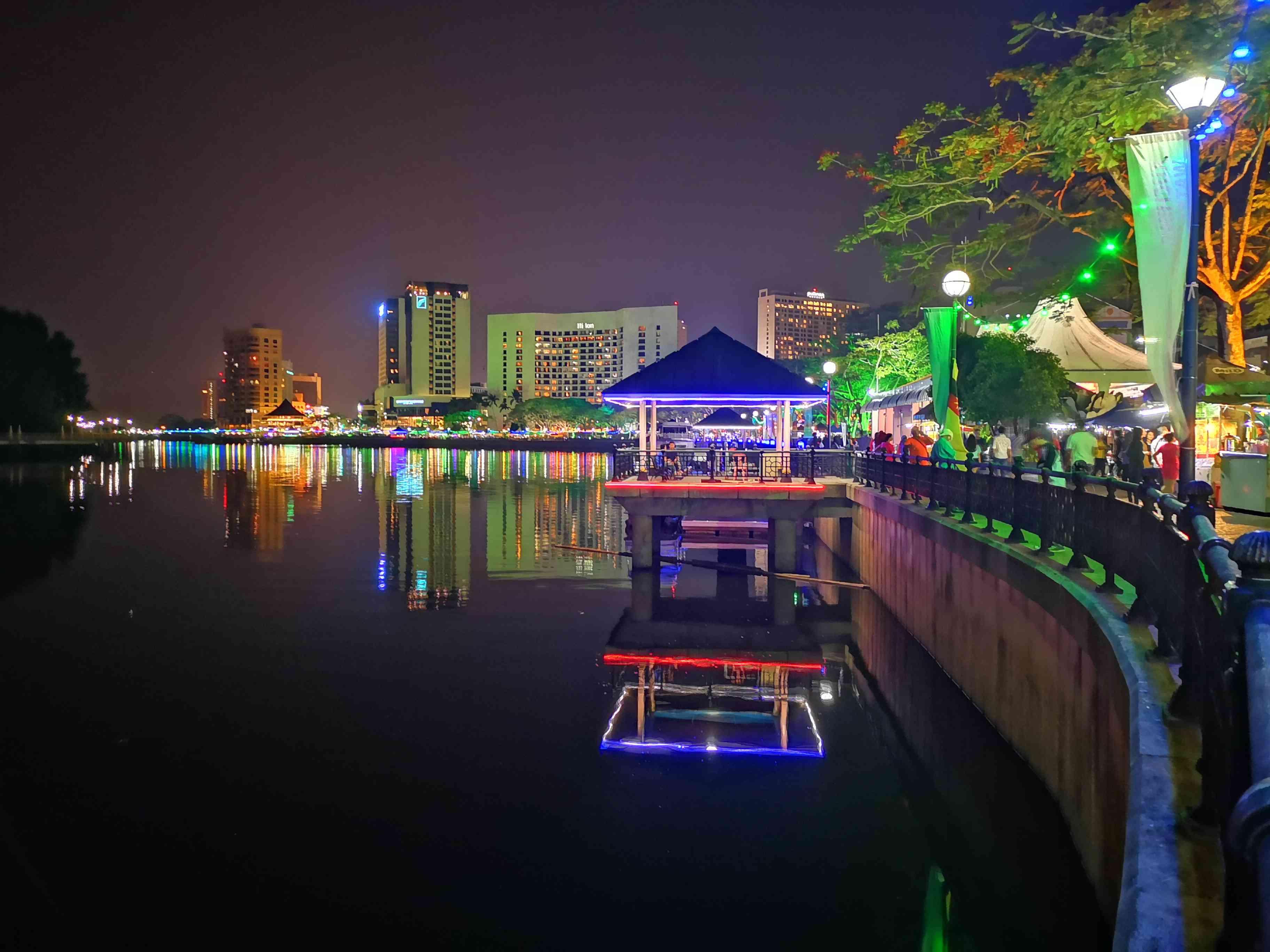 Riverfront walk lit up at night in Kuching, Sarawak, Borneo