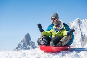 Man and kid sledding