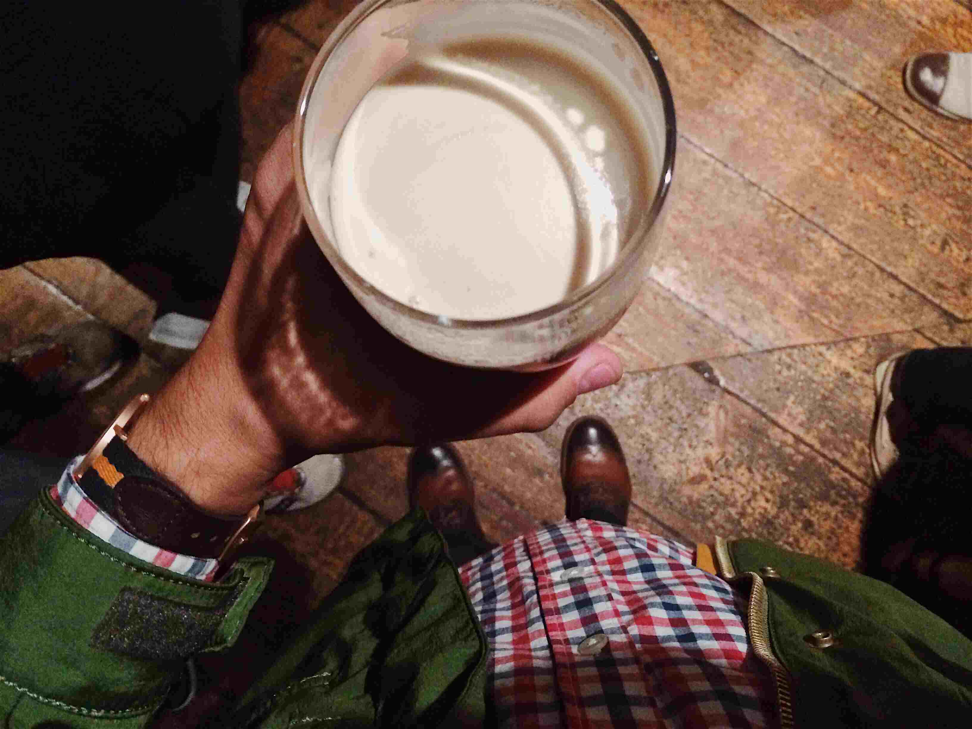 Drinking beer in a pub from personal perspective
