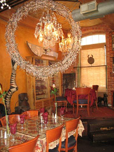 One of the attractions of the restaurant is its eclectic decor, with antiques and textiles from many countries plus romantic nooks for intimate meals.