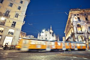 Milan tram passes in front of the Duomo
