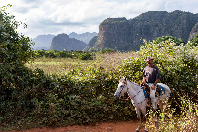 A man on horseback in Vinales Valley