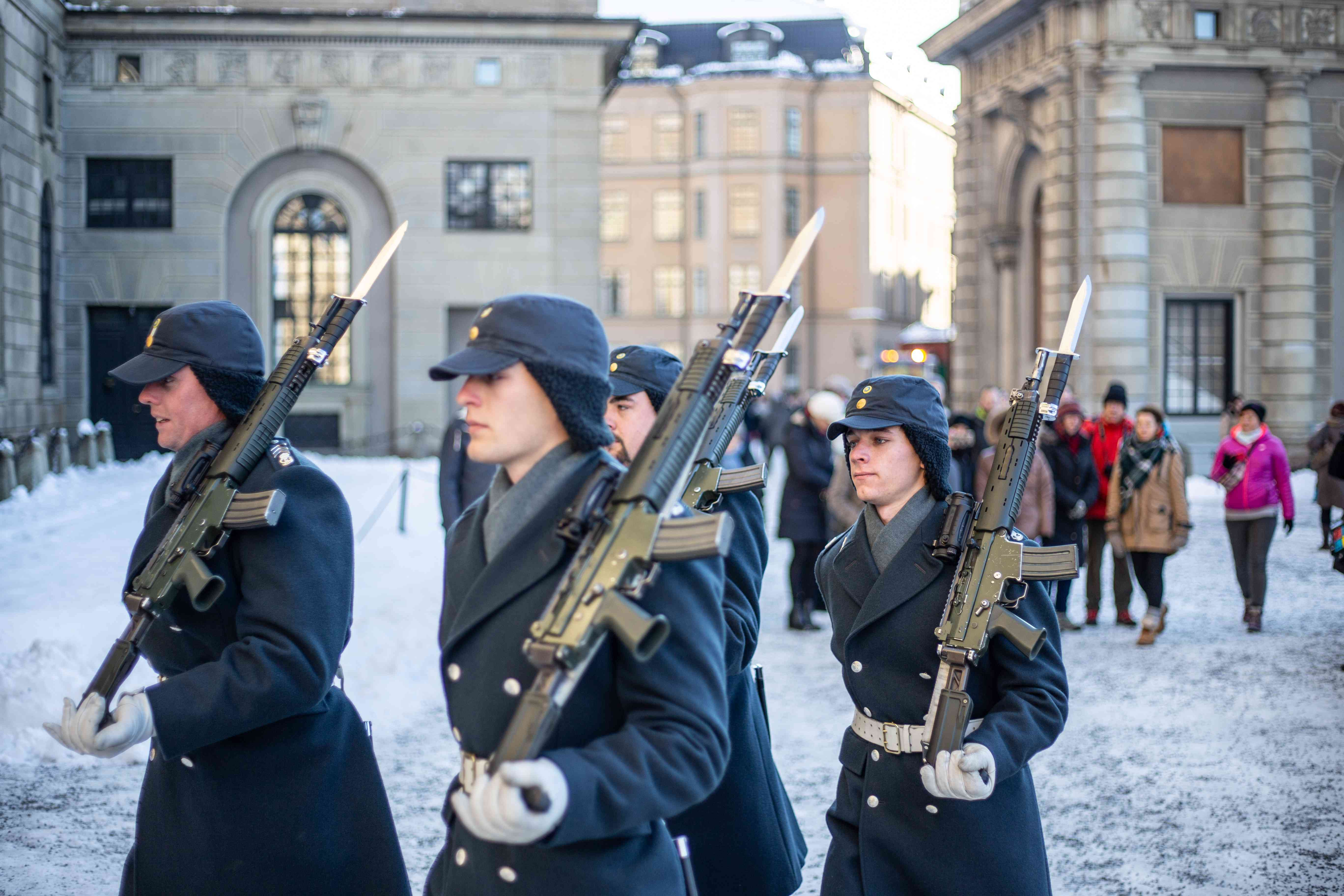 Guards marching with rifles during changing of the guards in Stockholm