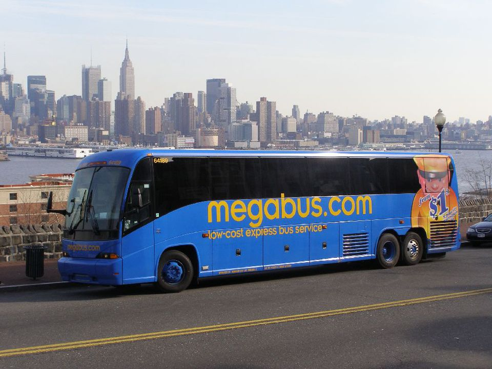 An intercity bus from the Megabus line with the New York City skyline in the background