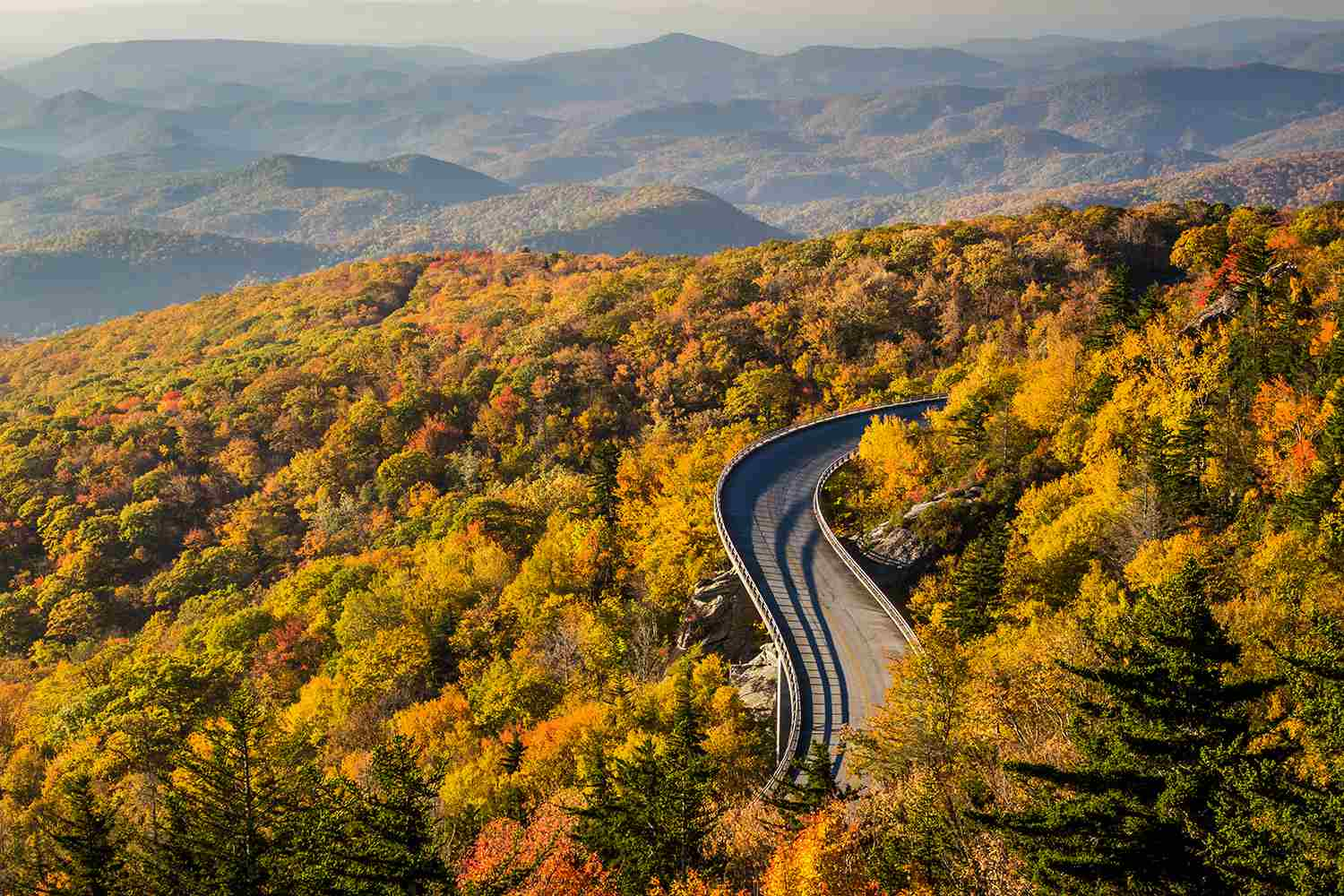 Unique viewpoint of the Linn cove viaduct at sunrise in Autumn on the Blue ridge Parkway, North Carolina, USA.