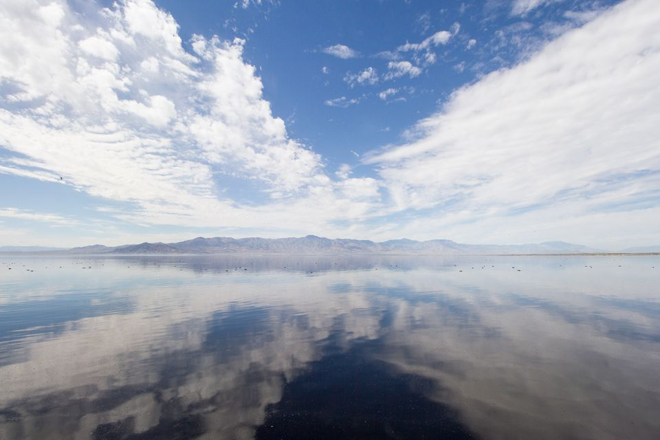 The Salton Sea with the clouds reflecting off the water