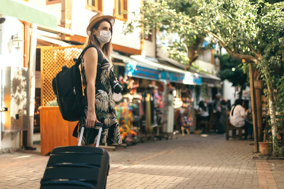 Woman in a face mask exploring Italy