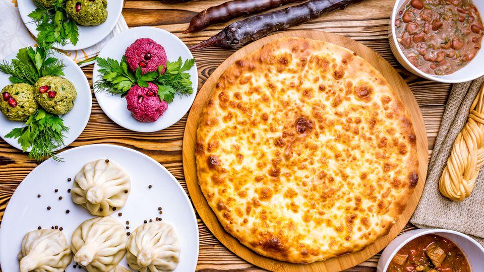 Georgian cuisine foodset from khachapuri, khinkali, pkhali, dolma, lobio top view