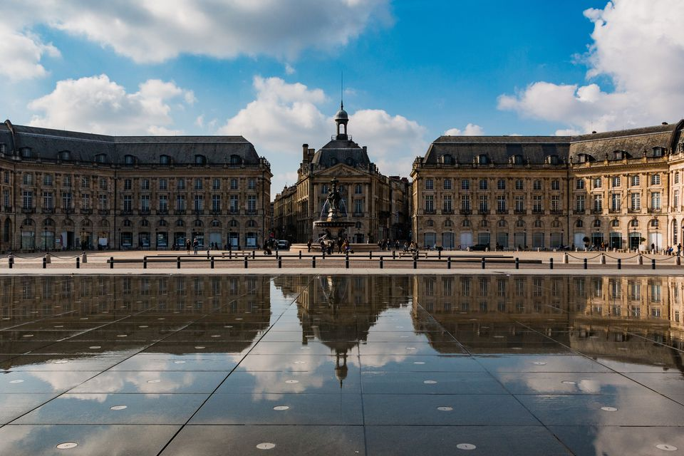 Reflection Of Place De La Bourse In Reflecting Pool At City