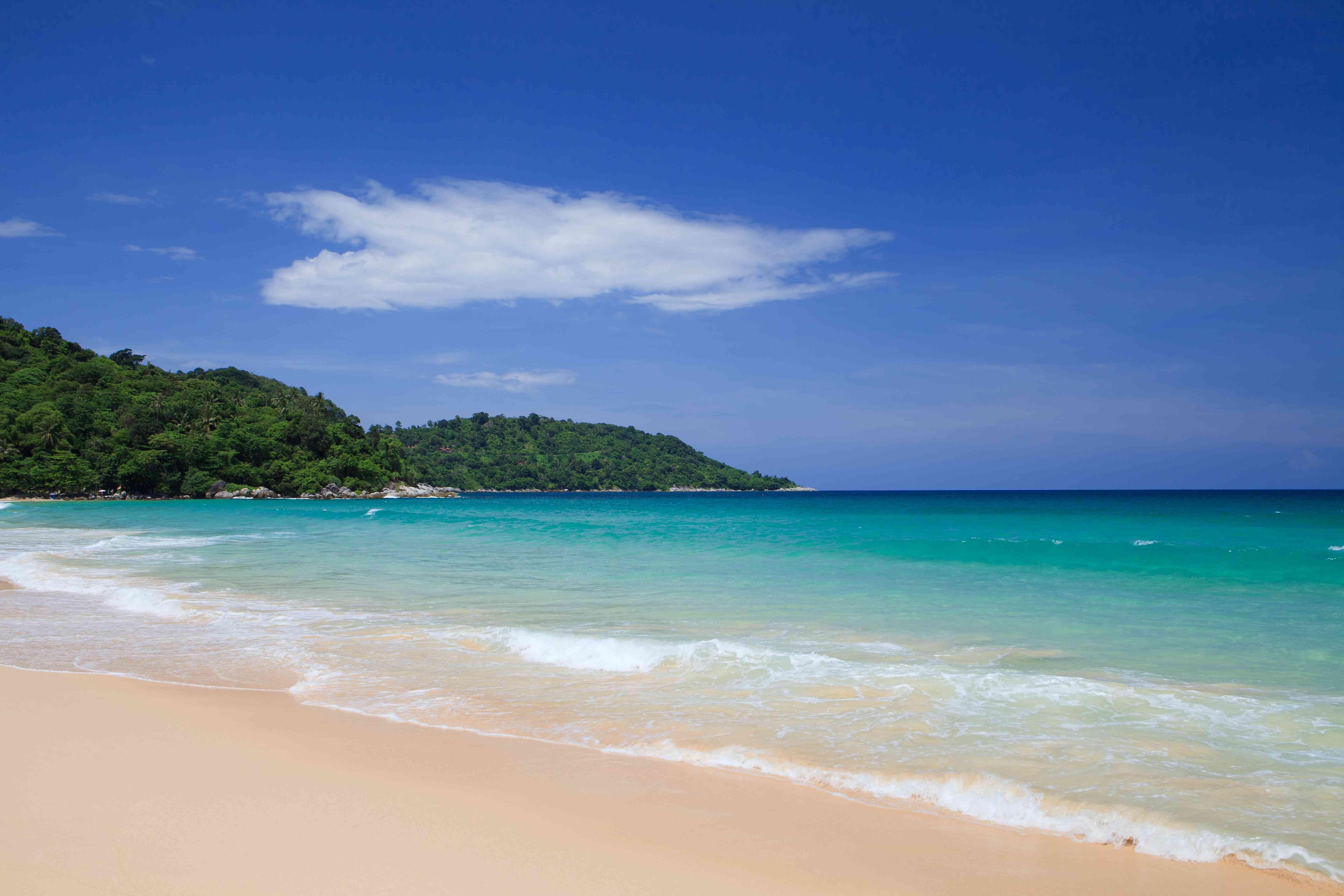 Tranquil beach with warm turquoise water