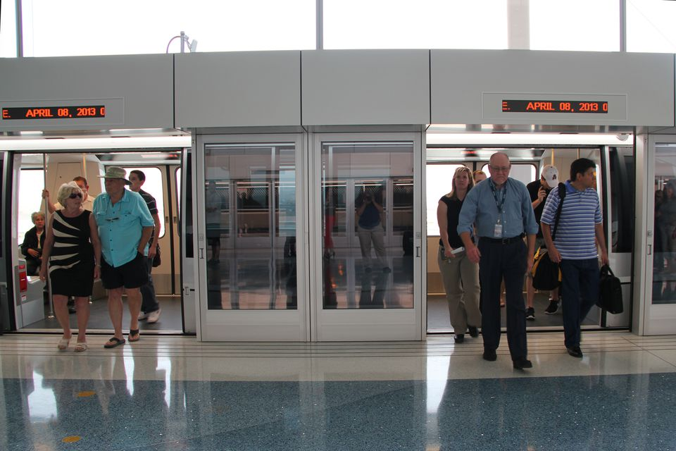 Passengers arrive at the PHX Sky Train station on the very first day of operation