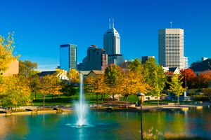 Indianapolis skyline with a fountain and park during Autumn