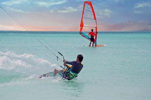 Kite surfer on Aruba island in the Caribbean at sunset - stock photo