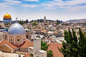 High angle shot of Jerusalem cityscape against the blue sky.