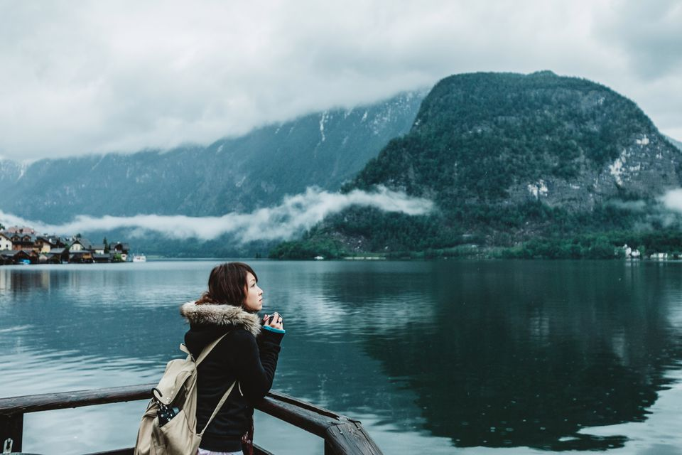 Person traveling solo looking out upon a lake