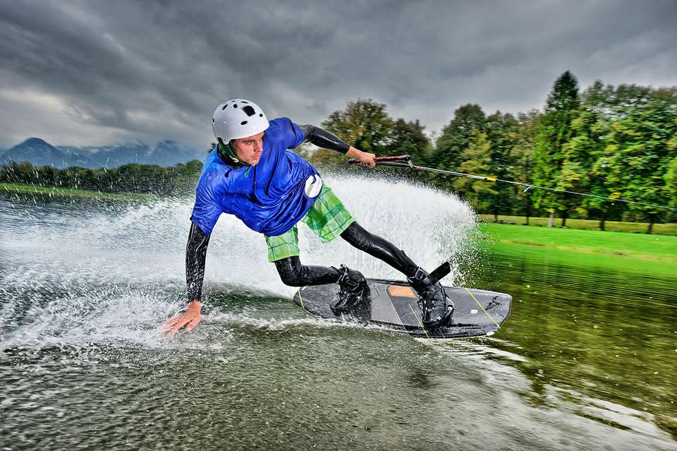 Young man surfing on a wakeboard