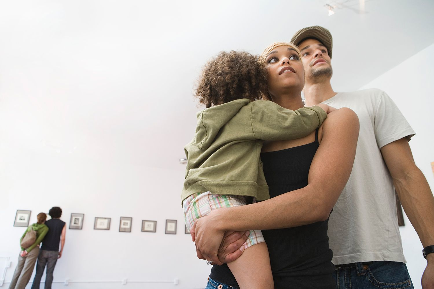 Couple with child at museum
