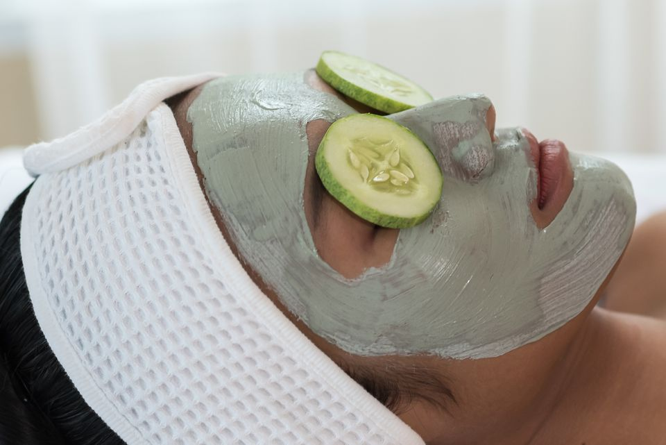Close-Up Of Woman With Facial Mask Lying At Spa