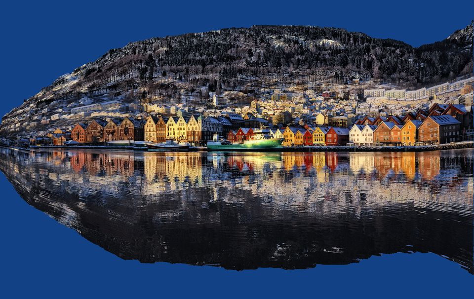 Reflection of houses on river in Bergen Norway