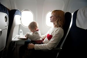 Mother with her baby boy in an aircraft