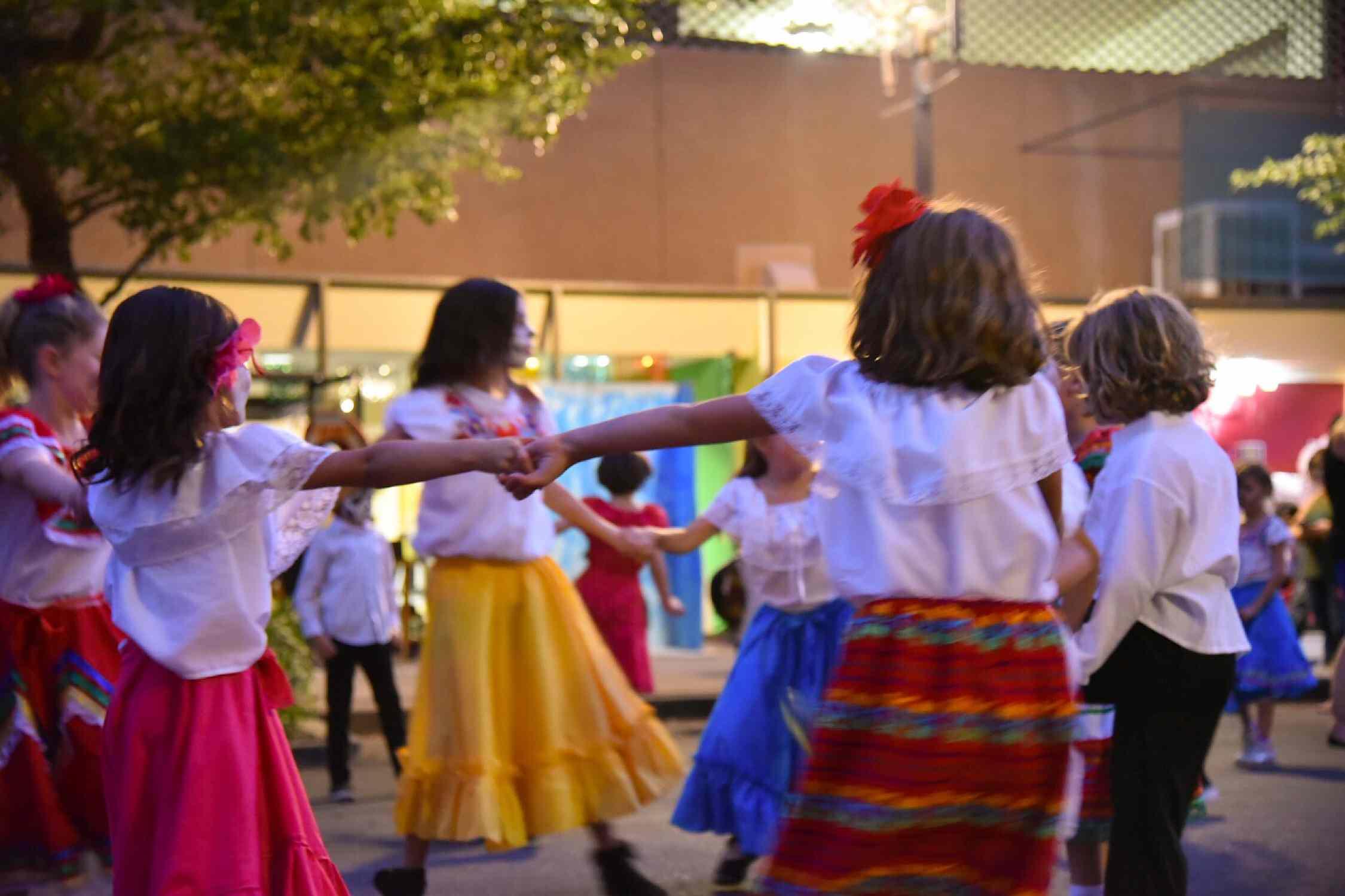 School aged kids performing publicly in downtown Phoenix for Dia de Los Muertos