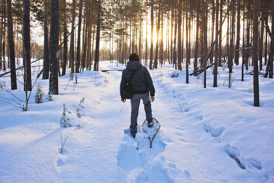 Man snowshoeing in woods