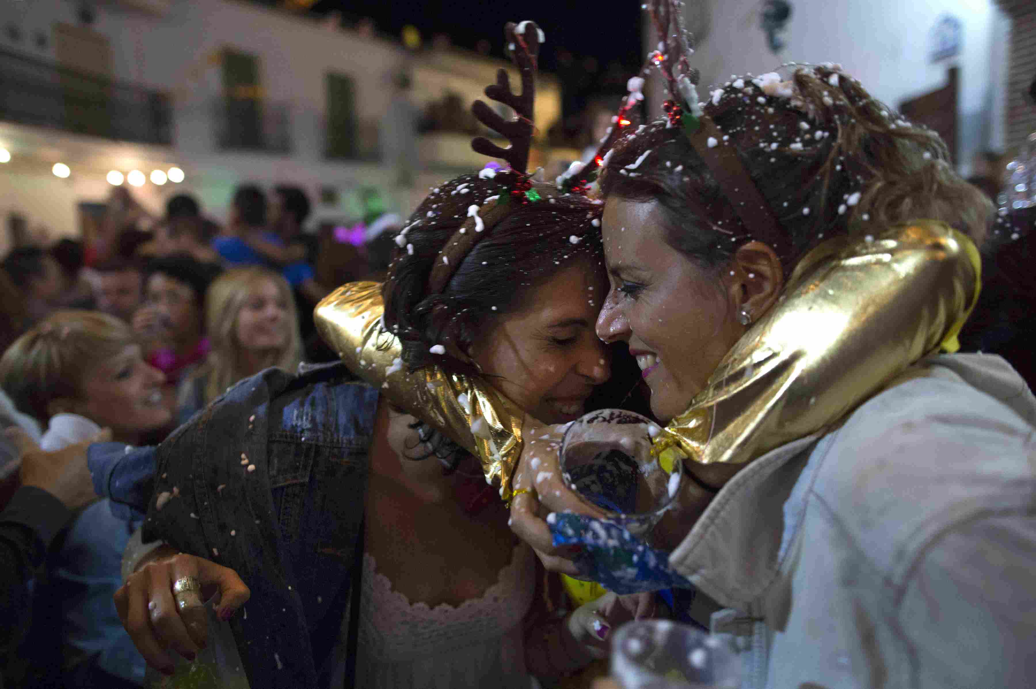 Two women celebrating New Year's Eve in August