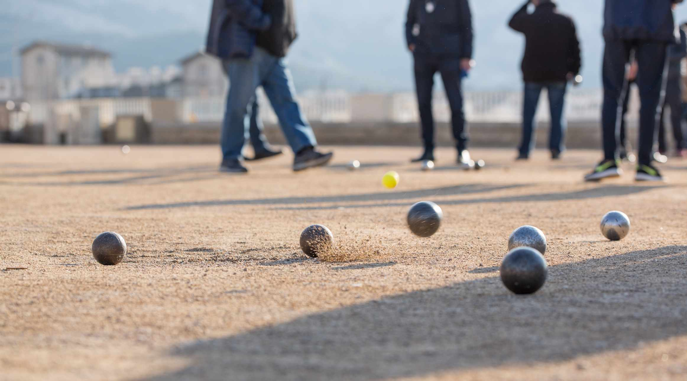 Friends play a game of pétanque, or boules, in Marseille