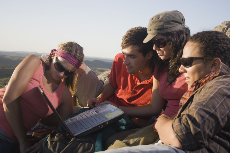 Students using laptop on vacation