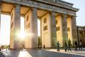 The sun shining through the legs of Brandenburg Gate