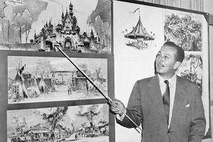 Walt Disney uses a baton to point to sketches of Disneyland, 1955