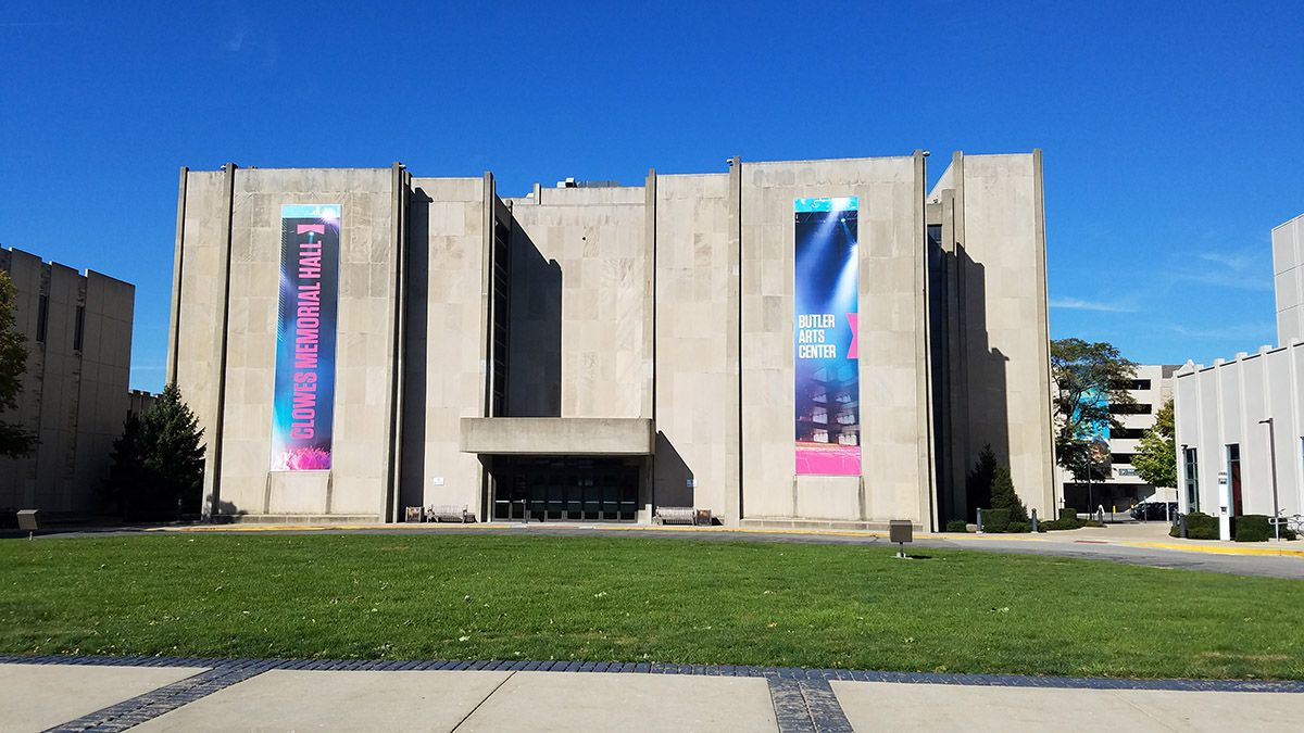 Brutalist concrete building, the Butler Arts Center, seen from across a lawn