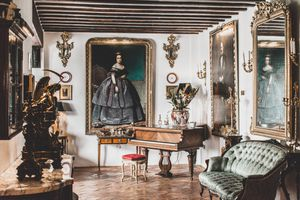 a room filled with paintings and artifacts