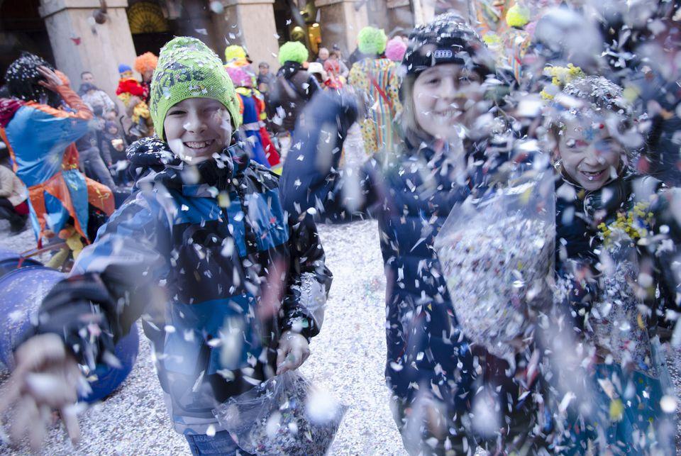 Italian children throwing confetti on Fat Tuesday