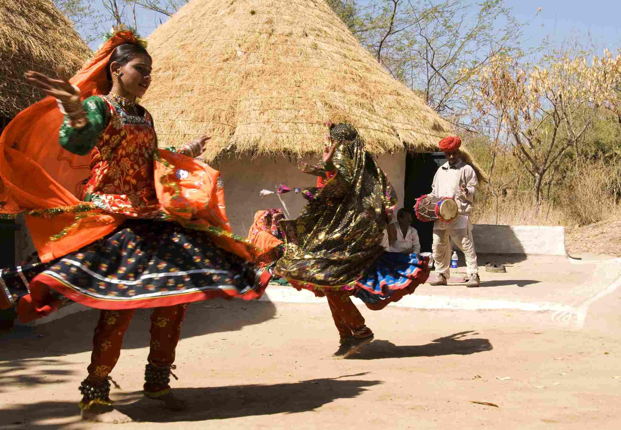 Two Indian women dancing in traditional dress