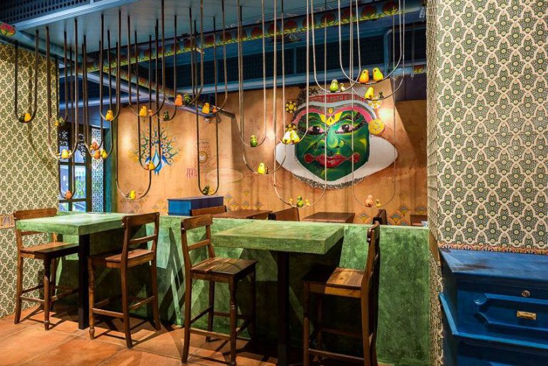 Green and brown restaurant dining room in Mumbai