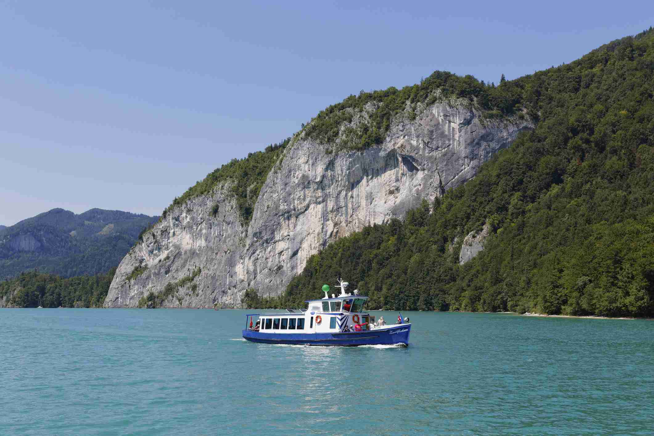 Passenger ship Zwoelferhorn in front of rock wall of Falkenstein, Lake Wolfgangsee, Salzkammergut, Austria